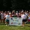 Julia Shuman, holding the banner on the left, and Julia Shuman, left on the banner, were joined by more than 30 people for their Walk For Wildlife on Saturday, July 17. (Hicks photo)
