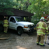 Police are investigating an incident in which this 1999 Ford F-250 pickup truck with an unidentified 2-year-old boy inside it rolled backwards into the house at 216 Riverside Road in the Riverside section of Sandy Hook about 8:48 am on Sunday, July 18. There were no injuries, but the truck and the house were damaged. The boy reportedly got inside the truck in his driveway at 209 Riverside Road and disengaged the vehicle's parking brake, after which the truck rolled backwards down that driveway, went across Riverside Road, and then entered the driveway at 216 Riverside Road where it struck a tree. The truck then hit the porch and the northern exterior wall of the Magda residence. There was a person inside the house when the incident occurred. The truck belongs to Jody Morris of 209 Riverside Road. Sandy Hook firefighters and Newtown Ambulance personnel responded to the scene.  (Hicks photo)