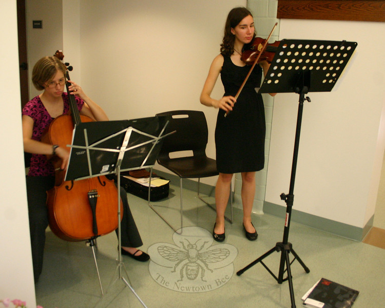 "Cellist Linea Kemsley (left) and violinist Alyssa Rodriguez provided music during the opening reception for ""Newtown Images, New England Charm.""  (Hicks photo)"