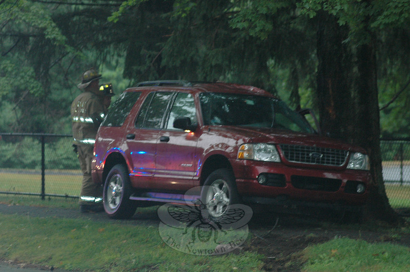 Motorist Marla Rubin, 55, of Trumbull was driving a 2004 Ford Explorer SUV on Wasserman Way, near Mile Hill Road South, about 6:30 pm July 13, when the vehicle went out of control on the wet road, spun around and struck some curbing, after which it went off the road and hit a tree. Newtown Ambulance volunteers transported Rubin to Danbury Hospital for treatment of injuries. A passenger was not injured. Hook & Ladder firefighters responded to the accident. Police gave Rubin a written warning for making a restricted turn.  (Voket photo)