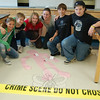 A group of students in this summer's Continuing Education SMART course Crime Scene Investigators stand together before giving a presentation to parents and gathered Reed Intermediate School staff on their crime scene on Friday, July 16, the final day for the program.  (Hallabeck photo)