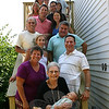 Marsha Moskowitz hosted a birthday party on July 10, two days after her mother Regina Goodman celebrated her 85th birthday. Four generations gathered for the celebration at Marsha's home at Appleberry Pastures in Sandy Hook. Front and center is Regina, holding her brand-new (and first) great-grandson, Jeremy Michael Ross. Second step, from left, is Marsha, one of Regina's daughters, and Ira Goodman, a son; third step, Felice (Goodman) Brenner, another daughter; fourth step, sons-in-law Joel Brenner, left, and Chris Platt; fifth step, grandson Michael Ross and his wife, Jennifer (Jeremy's parents); sixth step, grandchildren Jennifer Ross and Joshua Goodman; seventh step, granddaughter Deena Goodman and granddaughter-in-law Michelle Ross; and top step, grandchildren Hilary Moskowitz and Adam Moskowitz.  (Hicks photo)
