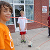 Friends, from left, Adam Robertson, Tiernan Keane, and Michael Schlesinger, all 11, linked straws together to share some Arizona Iced Tea outside of Salon Michelle and Dunkin' Donuts on Friday, July 16. The boys said a special thanks to Salon Michelle for allowing them to drink outside, and thinking their project was cool.  (Hallabeck photo)