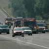 State police, Newtown Volunteer Ambulance Corps members, and Sandy Hook and Newtown Hook & Ladder firefighters responded to a two-vehicle accident on eastbound Interstate 84, in the area between Exit 10 and Exit 11, at about 4:13 pm Friday, July 16, during the evening rush. State police said motorist Joyce Brown, 54, of Bethel, who was driving a 2005 Honda Civic in the left lane of three lanes, slowed due to traffic conditions. Motorist Thomas Sanford, 35, of Naugatuck, who was driving a 2000 Chevrolet Malibu and was distracted by a cellphone, could not safely slow down and drove into the rear end of the Honda, state police said. The Chevrolet then struck some metal-beam guard railing along the left road shoulder. Brown was transported to Danbury Hospital for treatment of minor injuries. Sanford received violations for following too closely and for distracted driving.  (Gorosko photo)
