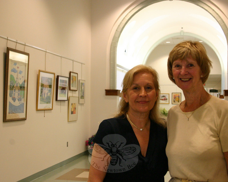 "Rosemary Rau (left) and Marianne Scanlon, on July 10 during the opening reception for ""Newtown Images, New England Charm."" The artists and SCAN members worked closely with First Selectman Pat Llodra to organize the first art exhibition at Newtown Municipal Center.  (Hicks photo)"