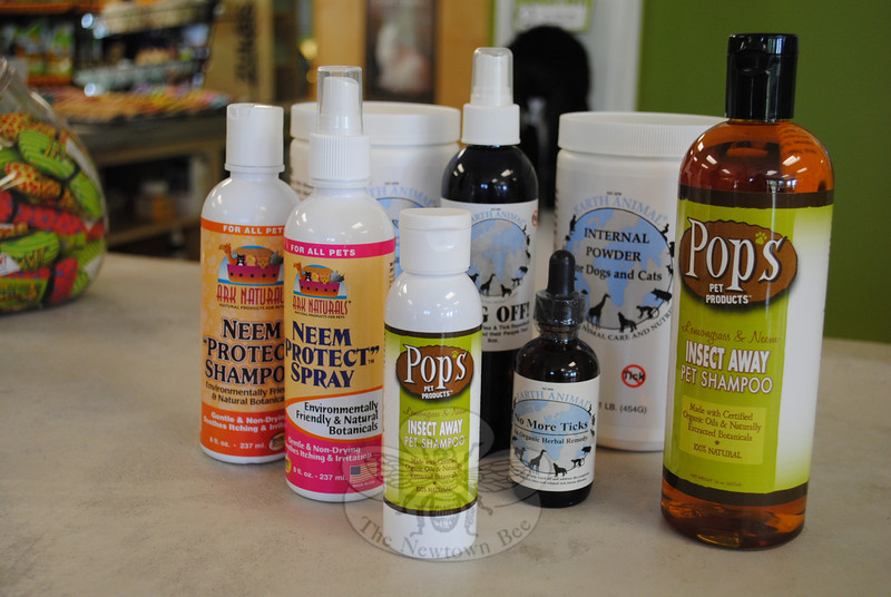 Alternatives to spot-on flea and tick treatments are available in some pet stores. Tom Novak, the owner of Your Healthy Pet on South Main Street, says pet owners will not find a simple solution to fighting pests, though, and must be diligent when using flea and tick products such as those pictured.  (Crevier photo)