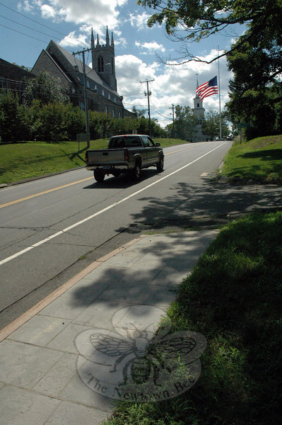 A gap in the existing sidewalk network in the town center lies along the north side of Church Hill Road, immediately east of the Main Street flagpole intersection.  (Gorosko photo)