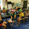 Daphne's Hat Shoppe instructor Marianne Mulvaney, back left, stood with students on Tuesday, July 27, as they held up their favorite hats created in the program, which started holding classes on Monday, July 19. Ms Mulvaney said students make about one hat per day in the course.   (Hallabeck photo)