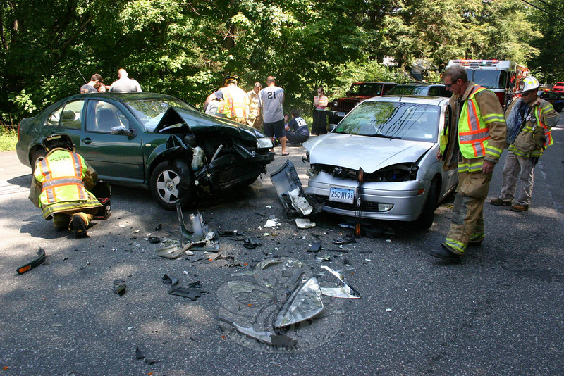 An accident involving two sedans occurred at the hazardous intersection of Currituck Road and Parmalee Hill Road about 1:55 pm on July 27. Motorist Barry Smith, Jr, 18, of 13 Knollwood Drive, who was driving a 1999 Volkswagen Jetta westward on Parmalee Hill Road, entered the intersection without stopping for a stop sign posted on Parmalee Hill Road and then collided with a 2002 Ford Focus being driven northward on Currituck Road by Hannah Keller, 17, of Brookfield. Keller and Ford passenger Mark Necio, 49, of Roxbury were transported by ambulance volunteers to Danbury Hospital. Hook & Ladder firefighters responded to the accident scene. Police issued Smith an infraction for a stop sign violation.  (Hicks photo)