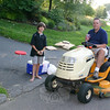 Eli Holmes was nearing the end of his day hosting a lemonade stand at the end of his Sandy Hook driveway when neighbor Dan McAloon drove up on his lawn tractor for an early evening refresher. Turns out Mr McAloon was working on his nearby lawn and decided to become Eli's first repeat customer of the day. Eli made about $6, he said, on Monday, July 26, and planned to go for another round of lemonade offerings on Tuesday.  (Hicks photo)