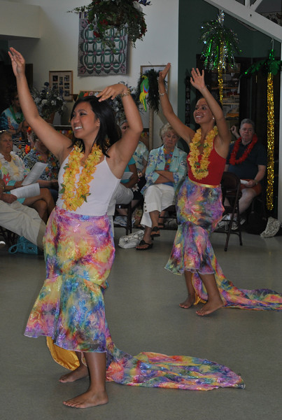 "Kai Foracker, right, and Jasmine, members of the Alay Philippine Cultural Dance Group of Greater Danbury, perform the ""Hawaiian Wedding Song"" at the Newtown Senior Center on Tuesday, July 27.  (Crevier photo)"