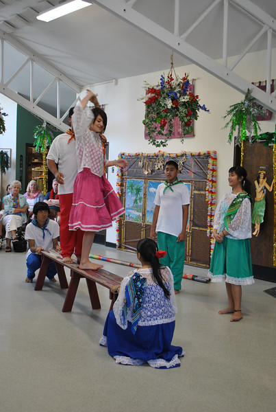 Members of the Alay Dance Group perform nimbly atop a narrow bench during the annual Hawaiian Luau at Newtown Senior Center.  (Crevier photo)