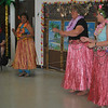 Josie Rodriguez, Alay dance director, left, leds hula dancers from Brookfield Senior Center through a traditional Hawaiian hula dance during a recent program at Newtown Senior Center. (Crevier photo)