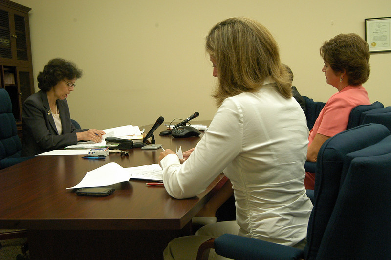 Freedom of Information Commission hearing officer Lisa Siegal, left, heard testimony from Board of Education Vice Chair Kathy Fetchick, center, and Chair Lillian Bittman on Friday, July 30, in Hartford for a hearing on Ms Fetchick's appeal against the school board regarding an executive session held during a meeting on April 6.  (Hallabeck photo)