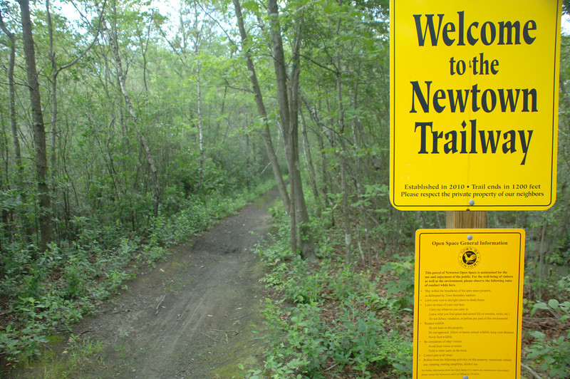 A welcome sign greets guests walking the rails-to-trails path that now extends from Monroe into Newtown.  (Bobowick photo)