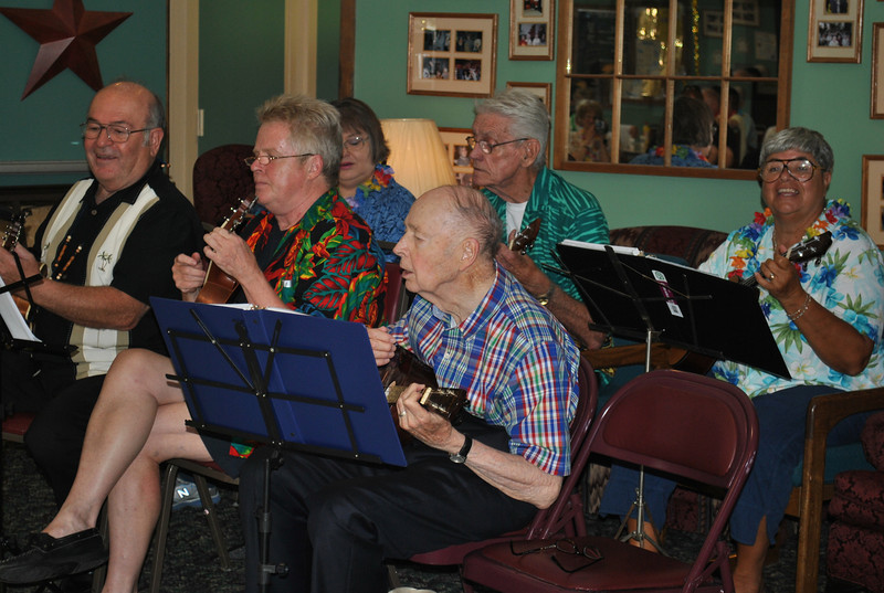 "Marty Sprock, far left, and Bob Taylor, second from left, are the leaders of The Hat City Uke Band from Danbury Senior Center. Here, the band performs ""Tiny Bubbles.""  (Crevier photo)"