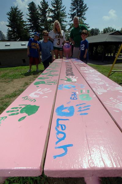 Proud of their freshly painted handprints and names written across a bench are, from left, Dylan Champagne, senior Parks & Rec Camp Counselor Casey Gilbert, assistant site director and art director Stephanie Bonacci, camp director Jeff Earle, and camper Brett Melchionno.  (Bobowick photo)