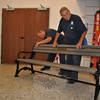 Public Works employees Dave Ferraro, left, and Pete Daccolti finish the assembly of a bench donated by the Andrew Willie family of Newtown on Monday, August 16. The bench is one of many that will be placed about the Fairfield Hills Campus in the near future. The Rotary Club of Newtown has donated funds to sponsor eight other benches, and The Fairfield Hills Authority is hopeful that local businesses and individuals will donate to buy still more of the benches, purchased through M.E. O'Brien of Massachusetts. The cost to sponsor a bench, with an affixed nameplate, is $1,000, and placement of the benches can be selected by the sponsor. The Willie family bench will be located in the courtyard of Newtown Municipal Building. For more information, call 203-270-9415.  (Crevier photo)