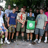 The Connecticut Yankee Council Boy Scouts of America sent 440 Scouts and leaders to the 2010 National Jamboree, held July 26–August 4 at Fort AP Hill, Va. Five adults and 22 Scouts from Newtown were among those who attended the annual event, which coincided with the 100th anniversary of the start of Scouting. Members of that group visited The New-town Bee recently to talk about the event. From left, front, is Scoutmaster Dave Barrett, Jo-hannes Böhrer, Tyler Coleman, Christine Wolf, Nick Wolf, and Scoutmaster Peter Lubinsky; second row, Tyler Hanna, Hutch Bermingham, Seth Barrett, Alex Taylor, Tarren Horvath, Rob Russo, and Brandon Capaldo.	  (Hicks photo)