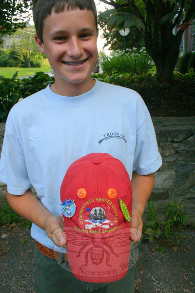 Collecting patches, pins and sometimes even autographs is a big part of any Boy Scout Jamboree. Newtown Troop 70 member Tarren Horvath shows off his BSA Jamboree base-ball hat with some new accoutrements, including the autograph of Dr Michio Kaku, a popu-larizer of science and best-selling author.  (Hicks photo)