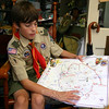While many boys had other activities to keep them busy, Troop 370 Boy Scout Timmy Moore spent many of his evenings with fellow Jamboree reporters in the media tent. Timmy earned a number of merit badges and filed stories while participating in the 2010 BSA Jam-boree, held at Fort Hill, Va., which is shown in the map he is holding.  (Hicks  photo)