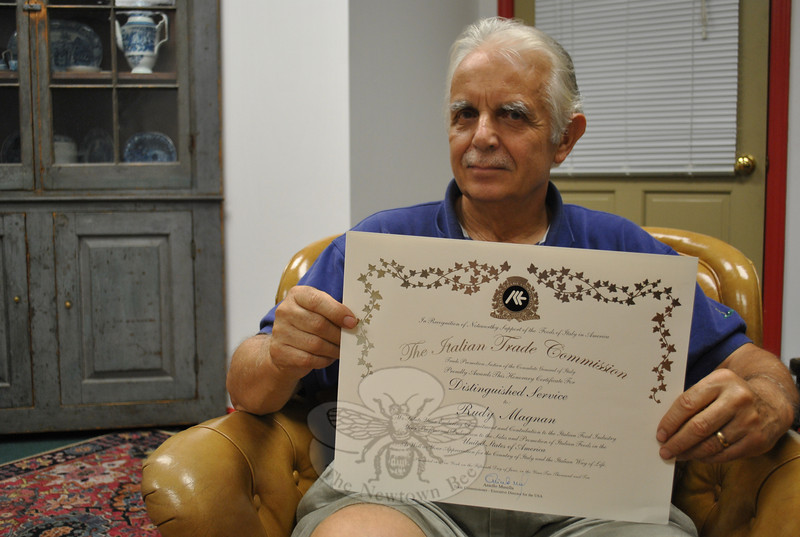 Rudy Magnan displays the certificate he was awarded by the Italian Trade Commission for his efforts in the 1980s and 1990s, importing Italian foods to America.  (Crevier photo)