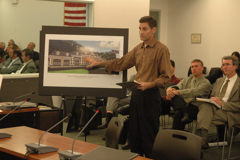 Architect Philip Clark of Claris Construction, Inc, describes aspects of a proposed 11,414-square-foot Newtown Hook & Ladder firehouse proposed for 12 Sugar Street to Planning and Zoning Commission (P&Z) members at an October 7 session. P&Z endorsed the proposal to the Borough Zoning Commission.  (Gorosko photo)