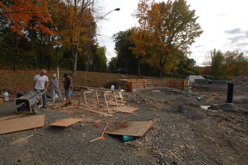 Poured concrete sections sit nearby the wooden frame where a skaters bowl will sit in the new skate park at Dickinson Park.  (Bobowick photo)