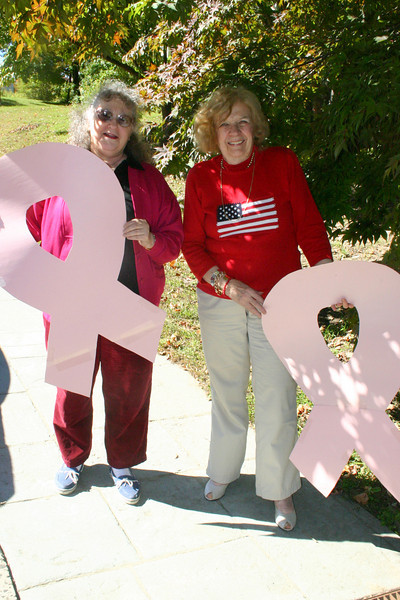 Newtown VNA members Betty Warner (left) and Mae Schmidle, holding oversize pink ribbons, would like to remind residents that October is National Breast Cancer Awareness Month. This year, in fact, is the 25th anniversary year of October being dedicated to awareness, education and empowerment, according to The National Breast Cancer Awareness Month organization.  (Hicks photo)