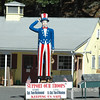 Newtown's top land use official contends that this giant Uncle Sam figure, which used to be on display at the now defunct Danbury Fair, is drawing attention to a mulch and landscaping business on Mt Pleasant Road. But after the owner originally told local officials the item was for sale, he has turned the brightly colored figure into a message of support for armed services members.  (Voket photo)