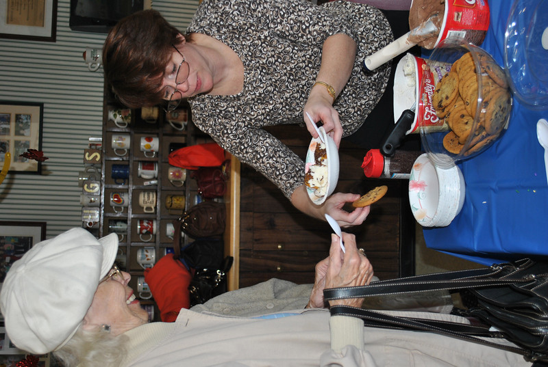 Bridget Richards of Beltone New England dishes out ice cream for Thelma Robb at the Newtown Senior Center on Thursday, October 7. Ms Richards was there with Beltone New England representative Jeffrey Weir, who presented a brief program on the types of hearing devices available and the proper care of hearing devices, while Senior Center members enjoyed their frozen desserts.  (Crevier photo)