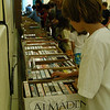 Eventgoers searched through VHS tapes and audiobooks on Wednesday, July 14, the final day of the 35th Annual Friends of Booth Library Book Sale.  (Hallabeck photo)