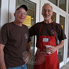 Friends of The C.H. Booth Library volunteers Eric Neidhurdt, left, and Dick Zang stood outside Reed Intermediate School on Saturday, July 10, prior to the opening of the Friends' 35th Annual Book Sale.  (Hallabeck photo)