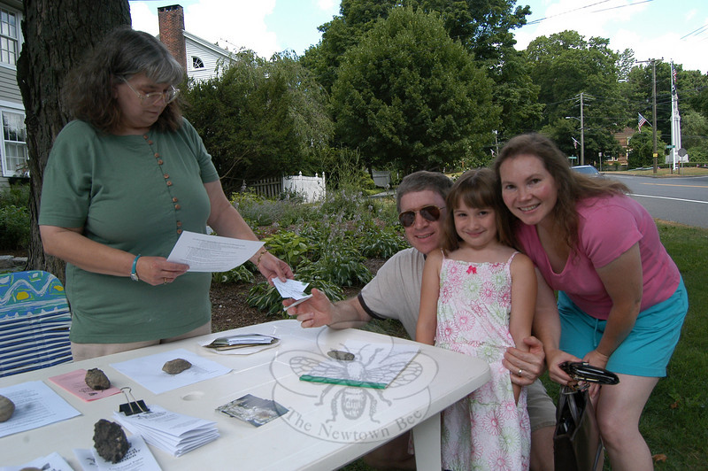 Kathy Ptacek, left, handed out tickets at Heirloom Gardens, 59 Main Street, on Sunday, July 11, for the Dig It! Gardens Tour, which featured four local gardens. Alan Katze, Katherine Katze, center, and Carolyn Katze, right, purchased their tickets for the tour. The ticket proceeds benefited The Bird & Butterfly Garden in Hamden, and the tour was sponsored by Dig It! Magazine.  (Hallabeck photo)