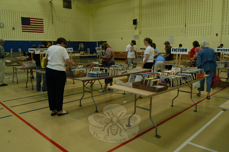 Books left at the sale on Wednesday, July 14, had been concisely gathered by volunteers for browsing ease.  (Hallabeck photo)