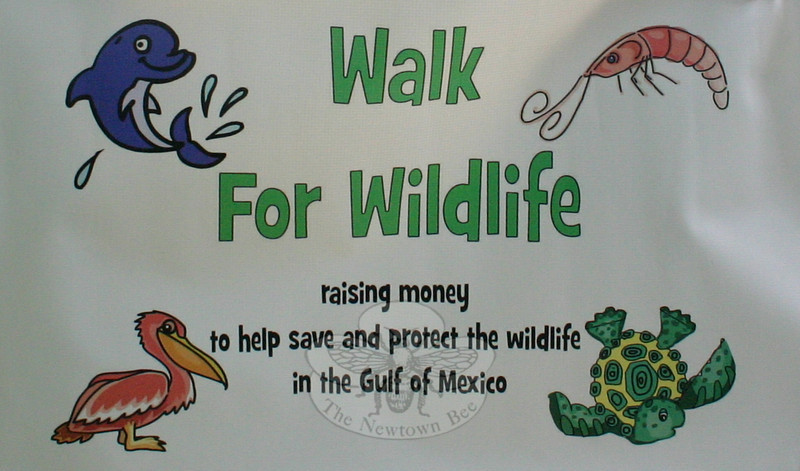 Close-up of the banner created for Liza Tananbaum and Julia Shuman, who are coordinating a two-mile Walk For Wildlife on July 17 that will double as a fundraiser for National Wildlife Federation and its efforts to protect and restore the wildlife and habitats in the areas affected by the BP oil spill.  (Hicks photo)