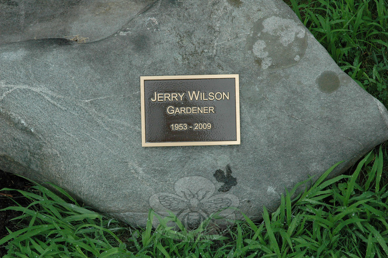 A memorial plaque for Jerry Wilson was installed at The Pleasance this week, honoring a master gardener who spent the last six years of his life caring for the plants there and digging in new trees and shrubs. Jerry died last September 20 at Blue Mountain Lake, N.Y., while taking part in the Adirondack Antiques Show. He was an endless source of horticultural information and his dedication to The Pleasance is missed. The plaque was mounted on a rock to the right of the fountain, courtesy of Ned Steinmetz of Brown's Monument Works, Route 25 in Monroe.  (R. Scudder Smith photo)