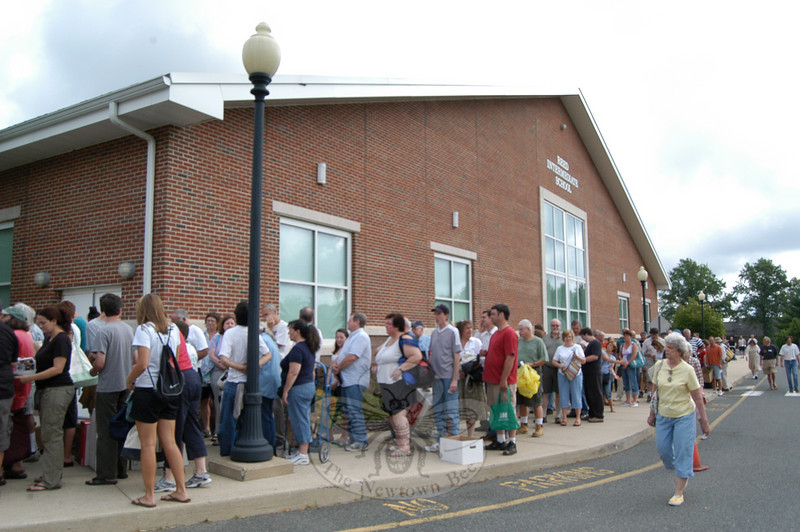 Before doors opened at 9 am, a line had formed outside of Reed Intermediate School on Saturday, July 10, th first day of teh 35th Annual Friends of C.H. Booth Library Book Sale.  (Hallabeck photo)