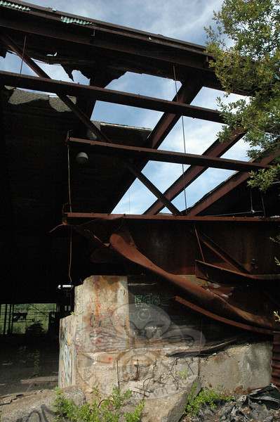 Knarled steel beams and damaged concrete blocks positioned near a partially fallen roof are the industrial ruins of the former Charles Batchelder Company on Swamp Road in Botsford.  (Gorosko photo)