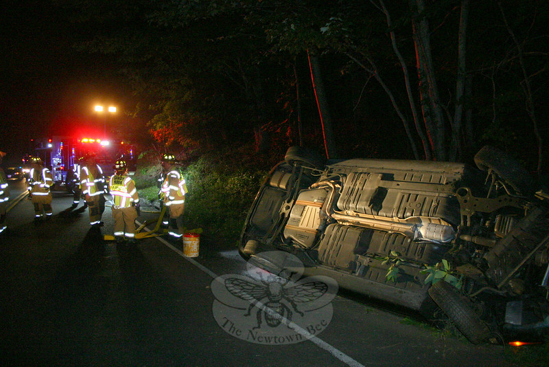 Motorist Kevin McCarthy, Jr, 18, of 12 Elana Lane was driving a 1997 Saturn SC-1 on Berkshire Road, near its intersection with Sherman Street, about 1:16 am July 13, when the auto went off the road, struck an embankment and then flipped over onto its roof, police said. McCarthy refused medical treatment at the accident scene, police said. Sandy Hook firefighters responded to the accident. Ambulance volunteers later transported McCarthy to Danbury Hospital to be checked for head/neck pain. Police charged McCarthy with driving under the influence and with making a restricted turn. Police held McCarthy on $1,000 bail for a court appearance later that day.  (Hicks  photo)
