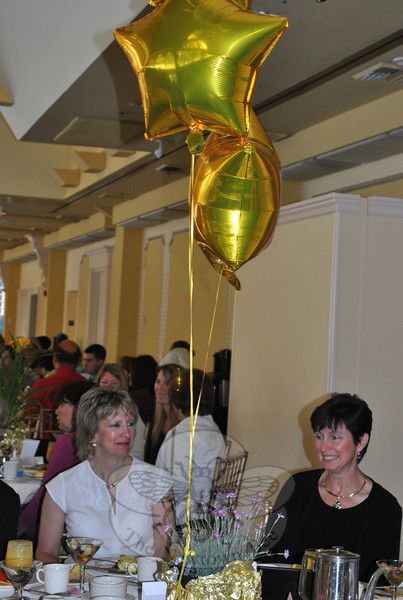 Lisa Pescetelli, left and Kathy Carillo visit over breakfast at the TR Paul table. TR Paul was a corporate sponsor of the event.  (Crevier photo)