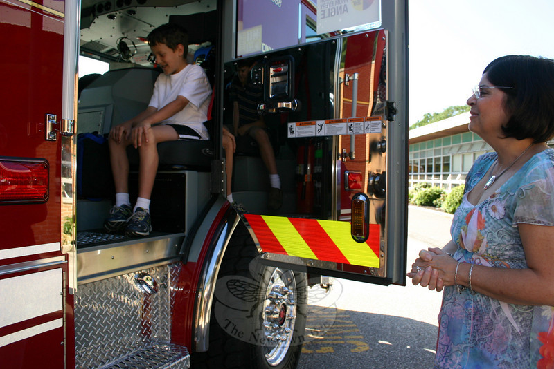 Sandy Hook School Principal Donna Page was at the front door when four of her students arrived at school on June 8 in an unusual mode of transportation. James and Julia Doyle and Garrett and Madison Fetchick were picked up at the Doyle home on June 8 and driven to school in Sandy Hook Fire & Rescue Company's brand-new 2010 Pierce Engine. (Hicks photo)