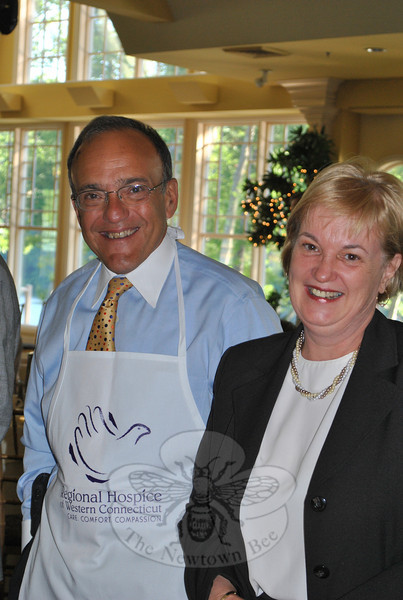 Newtown Savings Bank President John Trentacosta visits with Newtown tax collector Carol Mahoney. The bank was a corporate sponsor of the June 8 Regional Hospice breakfast.  (Crevier photo)