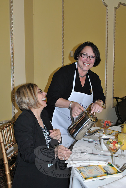 Eileen Rajczewski, seated, and Lisa Hintzen of Prudential Connecticut Realty share a laugh during the Regional Hospice breakfast. Ms Hintzen served as hostess for the realty company's table.  (Crevier photo)