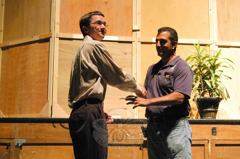 Newtown High School Senior Miles Aldrich shook hands with Eric Ventura after being named as the 2010 Dolores Ann Ventura Memorial Scholarship recipient at the annual awards night on June 2.  (Hallabeck photo)