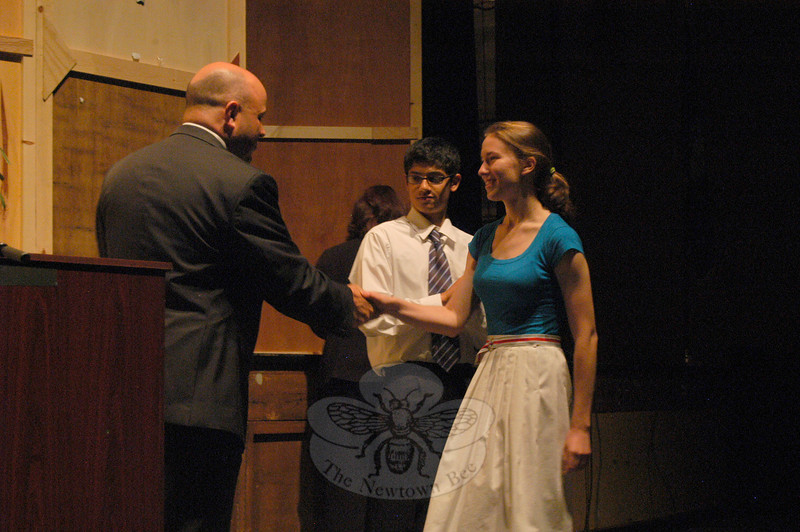 Newtown High School Principal Charles Dumais shook hands with this year's salutatorian Zoe DeStories after congratulating Zoe and 2010 valedictorian Amar Agashe, middle, during the school's annual awards night for seniors, held on June 2.  (Hallabeck photo)