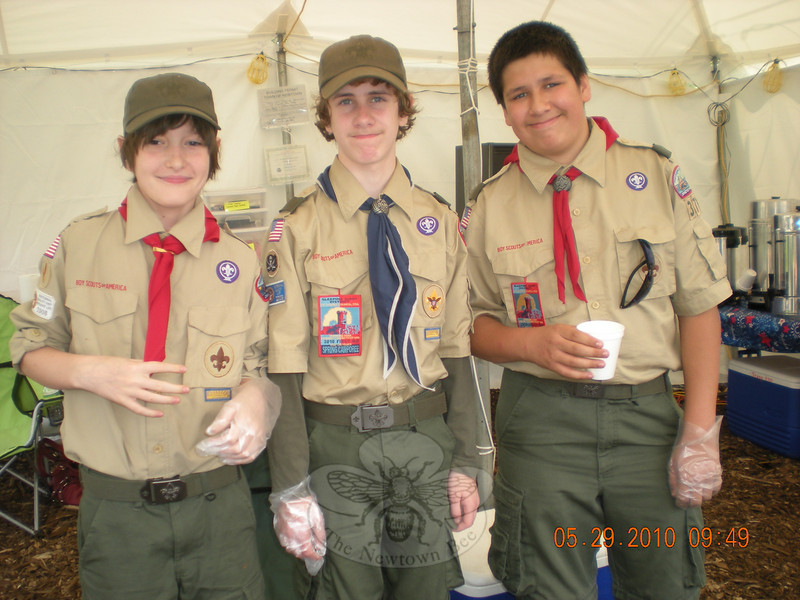 Boy Scouts Trevor Gaines, left, Ethan Burg, and Michael Alicea, right, worked at the annual Memorial Day weekend donut stop on Church Hill Road near I-84 Exit 10 on Saturday, May 29, giving travelers free donuts and coffee.  (Hallabeck photo)