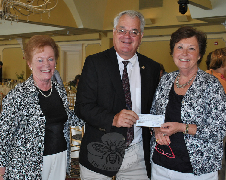 Newtown Chapter Regional Hospice breakfast chairpersons, Marg Studley (right) and Marie Sturdevant (left) accepted a check for $1,000 from Newtown Lions Club representative Walt Schweikert.  (Crevier photo)