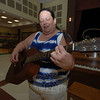 Susan Lang tunes her guitar during her talent show audition Thursday, May 27.  (Bobowick photo)