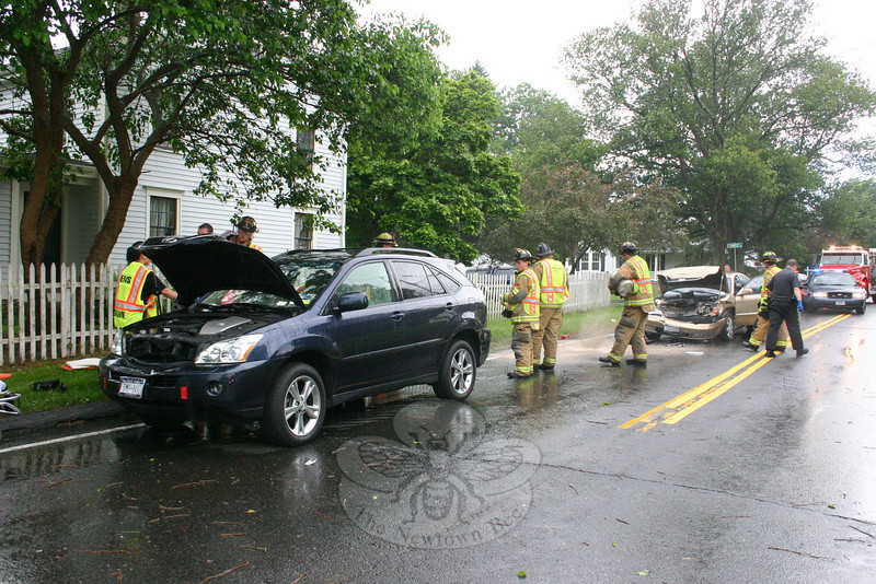 Police report a three-vehicle accident on southbound South Main Street at its intersection with Laurel Road about 3:12 pm June 6. Southbound motorist Joseph Devito, 43, of Monroe, who was driving a 2003 Nissan Pathfinder, slowed down for a noncontact vehicle ahead of him which was turning left onto Laurel Road. Southbound motorist Jessica Fisher, 39, of New York City, who was driving a 2006 Lexus RX-400 (above left), slowed down behind the Nissan. Southbound motorist Christina Ciamarra, 18, of 3 Avalon Way, who was driving a 2004 Suzuki Verona (above right), then struck the rear end of the Lexus, pushing the Lexus into the rear end of the Nissan. Ambulance volunteers transported Ciamarra and Fisher to Danbury Hospital to be checked for pain. Hook & Ladder firefighters went to the accident. Police issued Ciamarra an infraction for failure to drive a reasonable distance apart.  (Hicks photo)